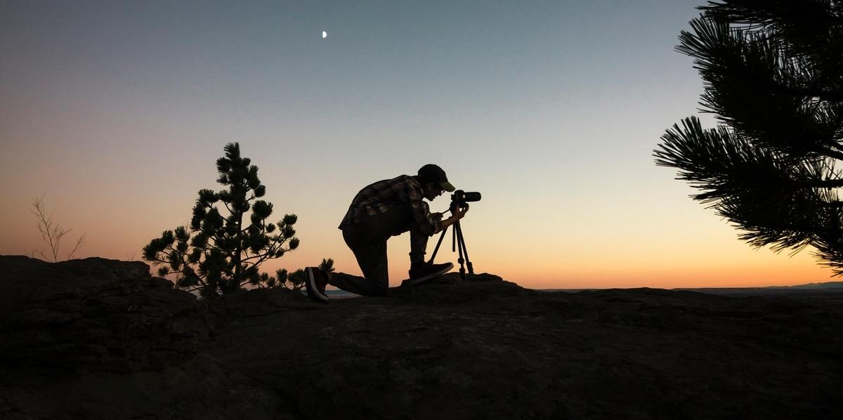 photographer taking long exposure image on tripod