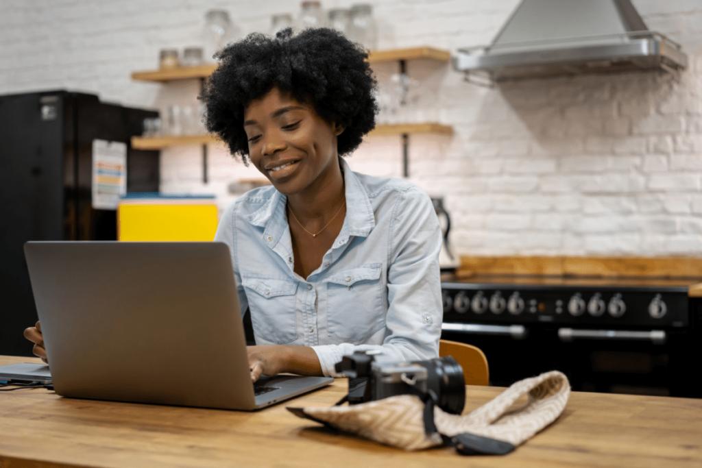 female freelance photographer editing photos on laptop
